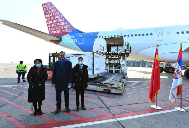 Serbian President Aleksandar Vucic (centre) and China's ambassador to Serbia Chen Bo (left) welcome the shipment of China's Sinopharm inactivated coronavirus vaccines at the Belgrade Airport in Serbia on Jan 16. — Xinhua