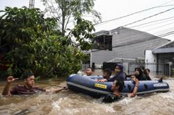 Floods cripple Indonesia's capital as thousands are evacuated and traffic is disrupted