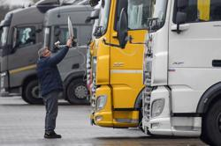 UK and France ease COVID test demands on truck drivers