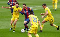 Late Cadiz penalty disrupts Barca winning streak in La Liga