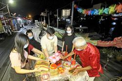 Quiet Hokkien New Year celebration at clan jetties