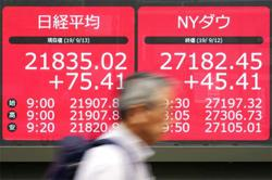 Asia shares edge up as bond yields, resources steal the show