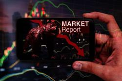 KLCI weighed down by gloves, banks