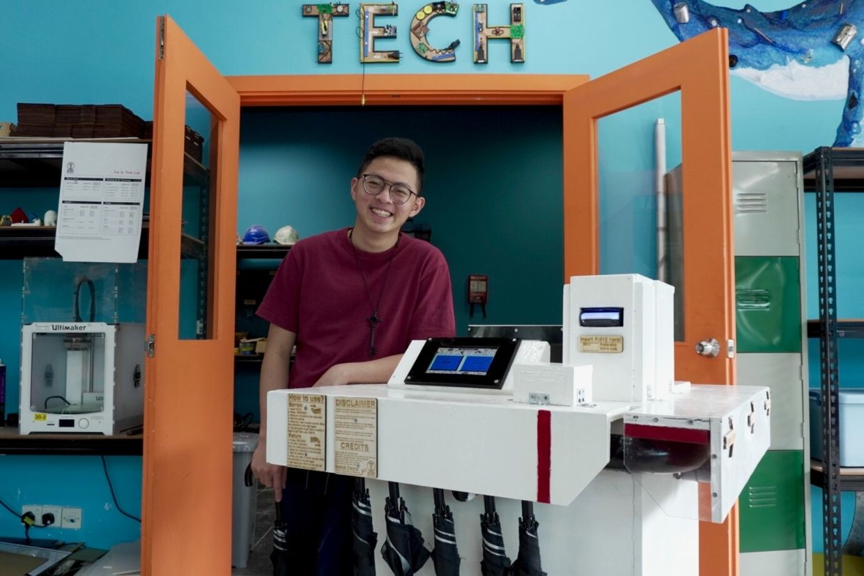 Bernard Yap with his umbrella borrowing machine, a product he created with the guidance and tools of Taylor's Me.reka Makerspace.