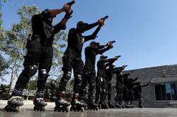 Pakistan police pop their rollerblades on to catch Karachi's criminals