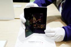Huawei 2020 revenue ticks up despite US sanctions, chairman says
