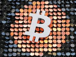 Bitcoin slumps below $50,000 as caution sweeps over crypto rally