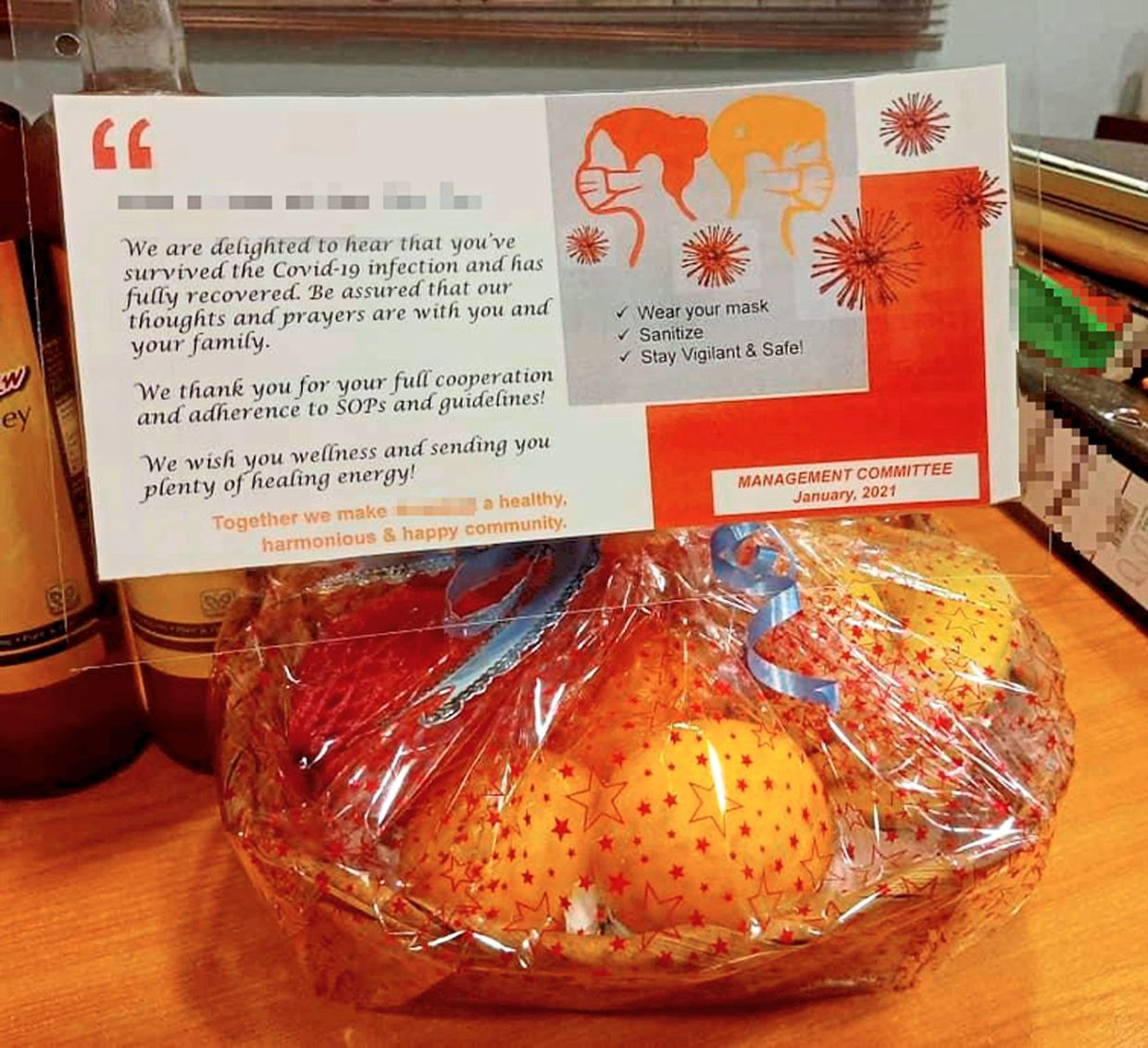 A thoughtful  gesture by a  condominium management  — sending a  fruit basket to residents who have recovered.