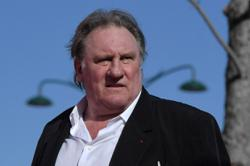 French actor Gerard Depardieu charged with rape in revived old case