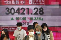 Asian markets drop as rate fears trump Powell reassurances