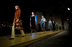 A year into the pandemic, Milan's grand and storied fashion runways stay virtual
