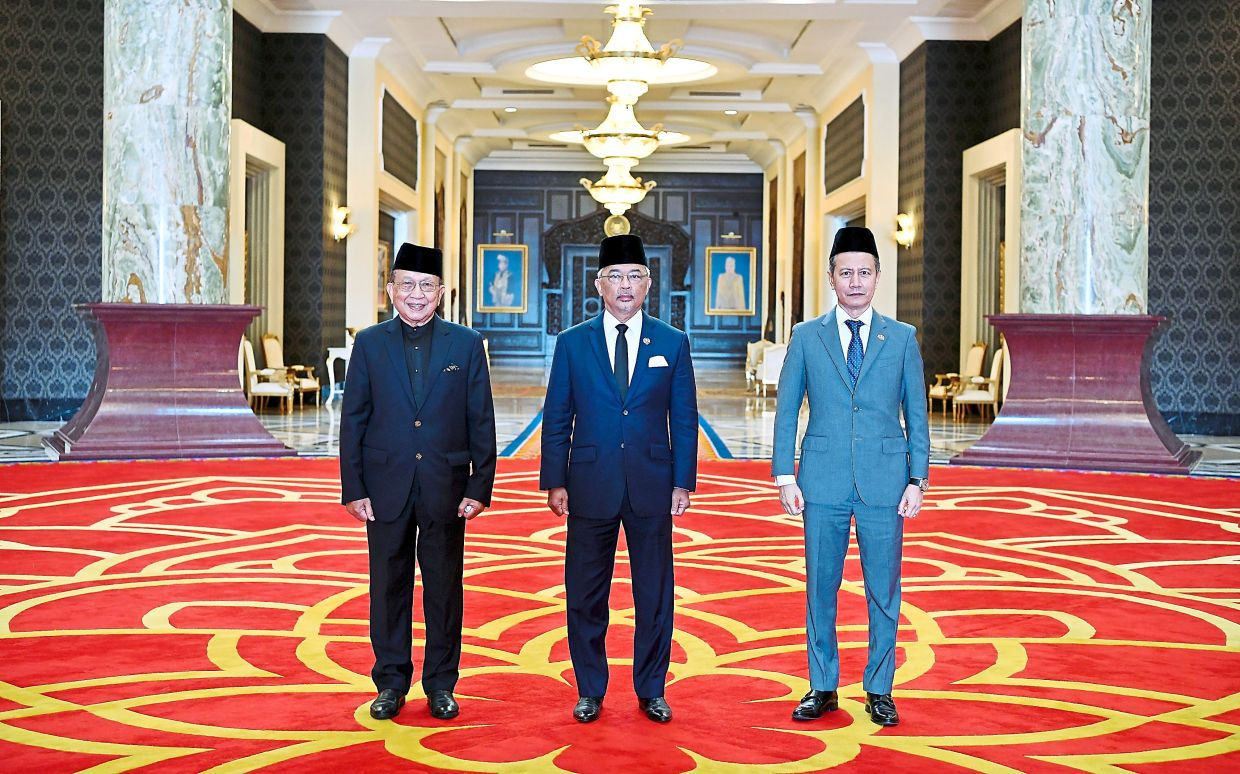In the front line: The King with Azhar (right) and Rais after the meeting. — Photo courtesy of Istana Negara