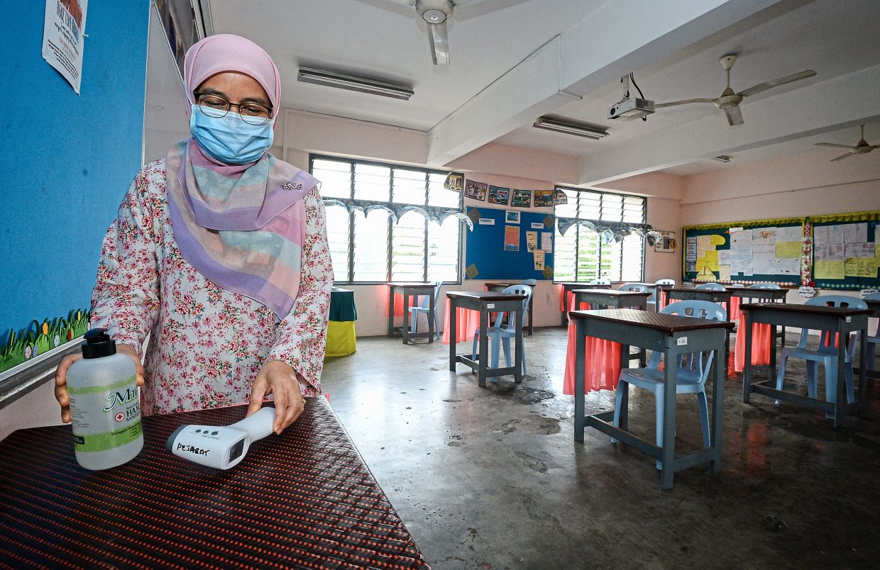 New protocols need to be in place for the reopening of schools, including hand sanitising and temperature scanning. Photo: Filepic