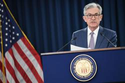 Data-focused Powell paves way for era of extended loose Fed policy