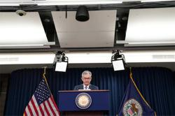 Powell signals Fed to keep buying bonds