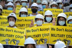 Supporters of Myanmar coup attack rival in Yangon