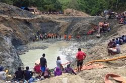 Three killed, scores missing after Indonesian gold mine collapse