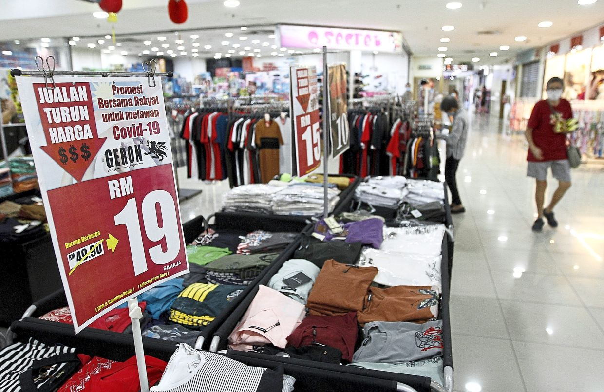 Clothes sellers in malls are slashing their prices after the festive celebration.