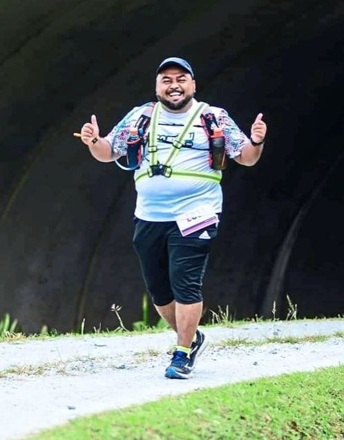Aman, who is on a weight loss mission, was the first person to sign up for Putrajaya 100 Miles 2021 and received the bib number A0001.