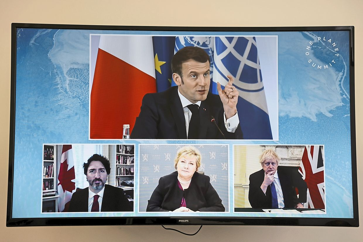 Could more future meetings be held virtually – like this one between (clockwise from top) French President Emmanuel Macron, British Prime Minister Boris Johnson, Norwegian Prime Minister Erna Solberg and Canadian Prime Minister Justin Trudeau during the recent One Planet Summit – to reduce air travel, and thus, carbon dioxide emissions? — AP