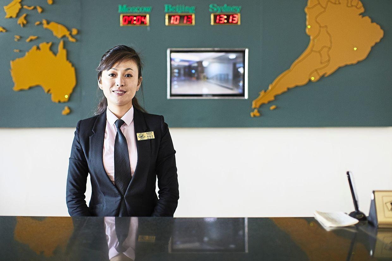 A front-desk staff at the Changgwangsan Hotel.