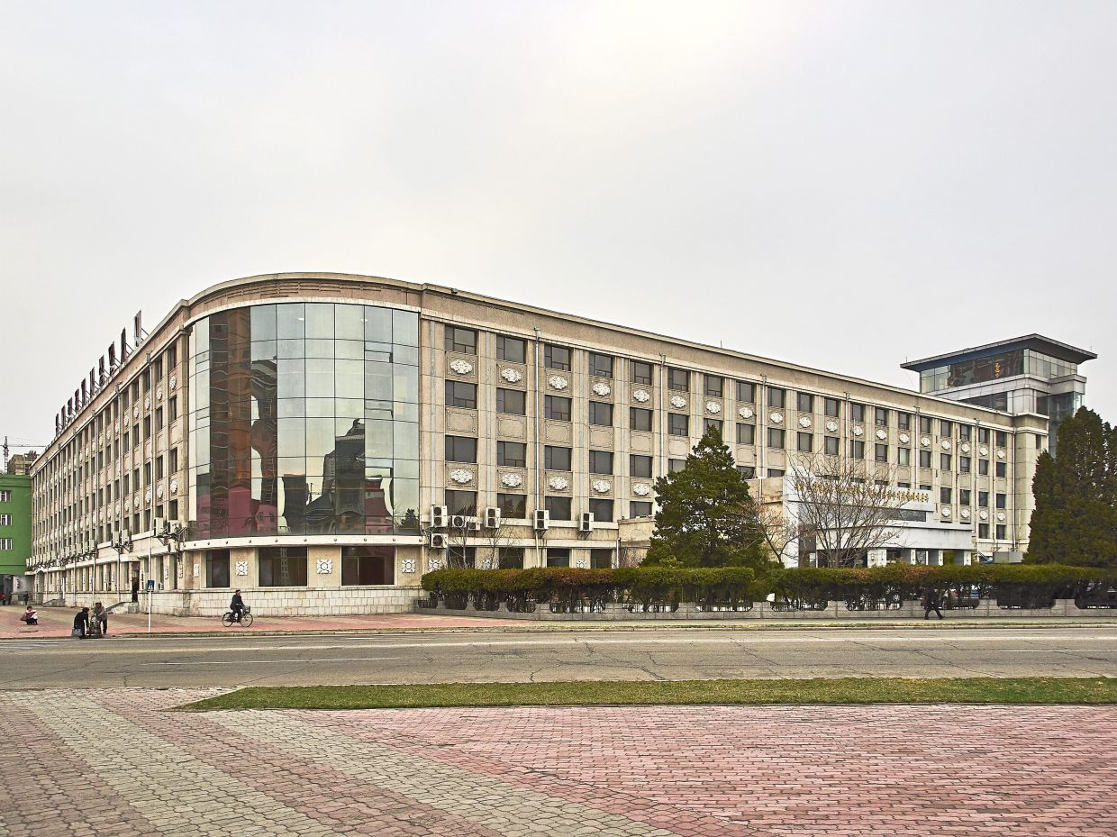 The Pyongyang Hotel, which sports a glass and concrete facade.