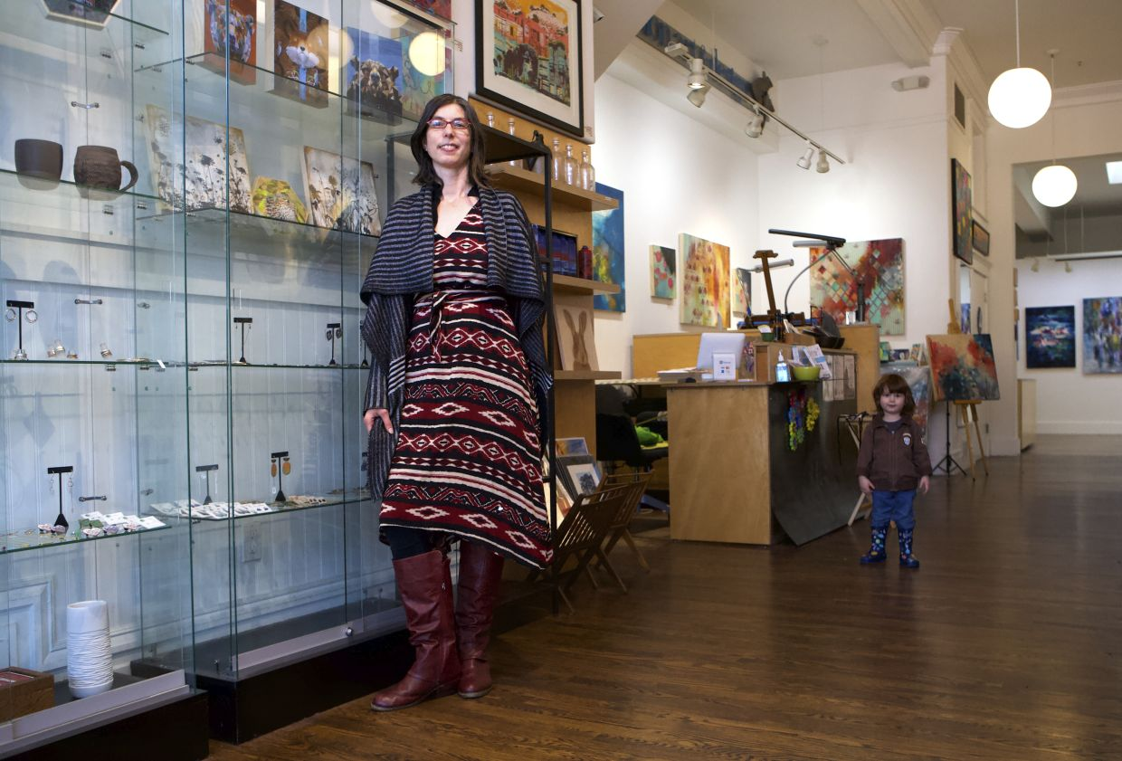 Eden Stein appears with her son Luca at her gallery Secession Art & Design SF in San Francisco. Stein said making art sales during the pandemic has felt a little like a wedding reception: She has reconnected with friends and clients from throughout the gallery's 13-year history. Photo: AP