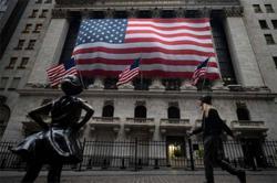 Wall Street ends sharply lower, tech selloff weighs as bond yields climb