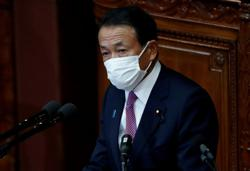 Japan cautious on global economy, urges support for poor nations