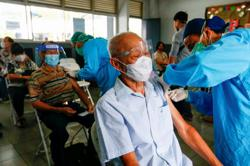 Tempers flare in Indonesia as the privileged few get vaccinated ahead of the queue