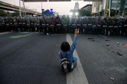 Thai protesters, police clash near base of army unit king controls