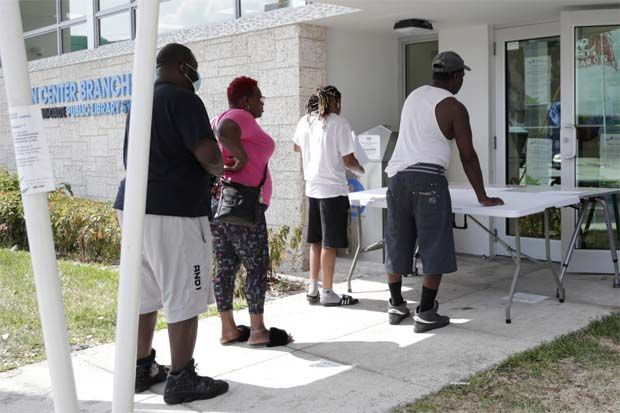 People line up to pick up jobless claim forms.