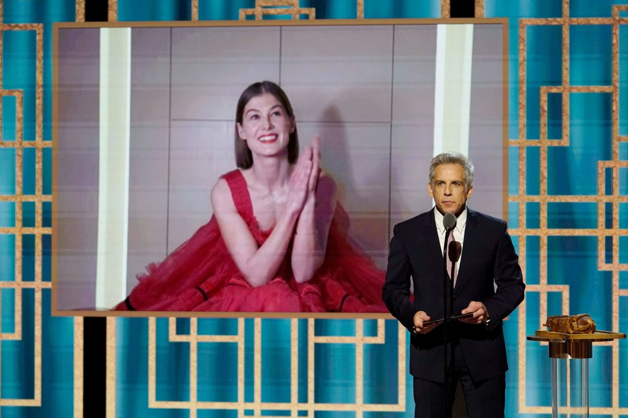 Rosamund Pike (on screen) accepting the Best Actress - Motion Picture - Musical/Comedy award for