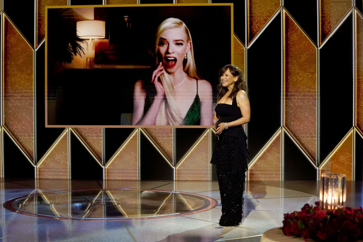 Anya Taylor-Joy (on screen), winner of the Best Actress - Television Motion Picture award for 'The Queen's Gambit' reacts as Rosie Perez presents onstage.