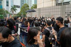 Security tight as crowds gather outside HK court for subversion hearing