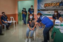 Philippines starts Covid-19 vaccination drive amid supply woes