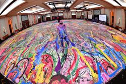 British artist hopes to spark a humanitarian movement with his giant painting