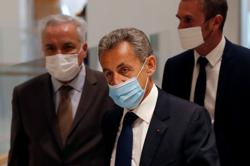 French court finds former President Sarkozy guilty of corruption