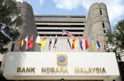 Bank Negara seen holding key rate as infections slow, Covid-19 vaccination starts