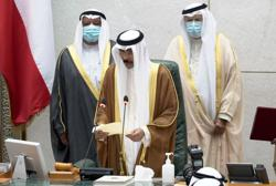 Kuwait emir issues decree approving new cabinet