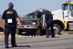 U.S. probes role of human smuggling in Mexico border collision that killed 13