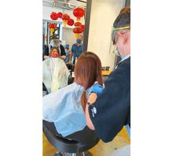 18 get haircuts in support of hospital's cancer fund