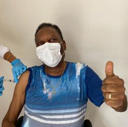 Former soccer star Pele gets vaccinated in Brazil