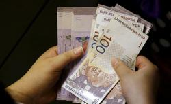 Ringgit rises on moderate buying interest
