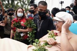 Thai activist accused of burning king's portrait arrested