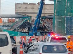At least five people trapped in van after bridge under construction collapses