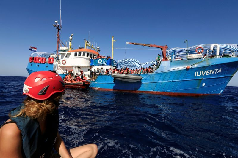 FILE PHOTO Ronia 24 a member of the German NGO Jugend Rettet watches rescuers from the Save the Children NGO transferring migrants from the vessel Iuventa to their ship after her organisation rescued them from an overcrowded dinghy during an operation off the Libyan coast in the Mediterranean Sea September 21 2016. REUTERSZohra Bensemra