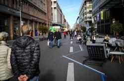 German business decries gradual easing of coronavirus curbs as