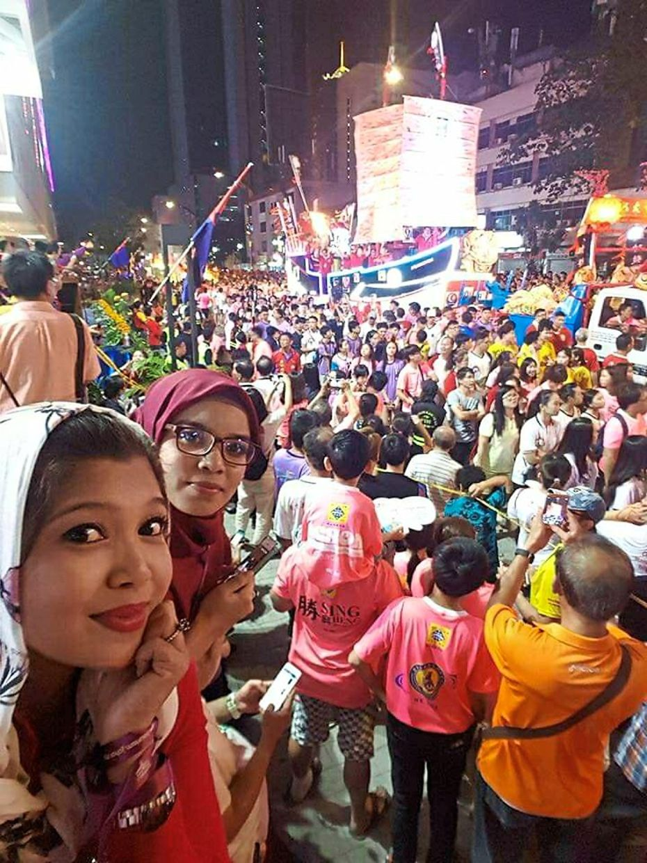 Nuha (left), 47, has attended the Chingay procession four times and enjoys watching the floats go by.