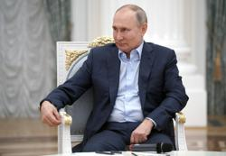 Putin calls for internet bound by moral rules, criticises opposition rallies